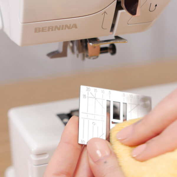 How to Clean and Oil Sewing Machines with a CB Hook - Hook Cleaning - remove the needle - remove the stitch plate - release bobbin case - bobbin case removed - dust out your machine - cleaning with a soft cloth - add the stitch plate