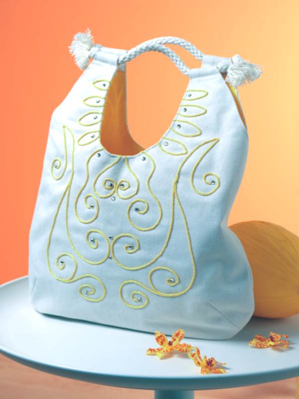 Purse embellished with free-motion couching