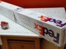 FedEx boxes combined to form a long rectangular box for the quilt