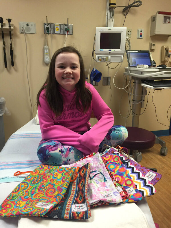 Macy Nunan Sews Beads of Courage Bags for little patients like her