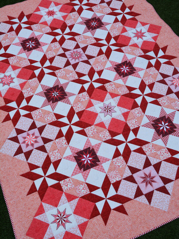 The red version of the Stardust Quilt by Amanda Murphy