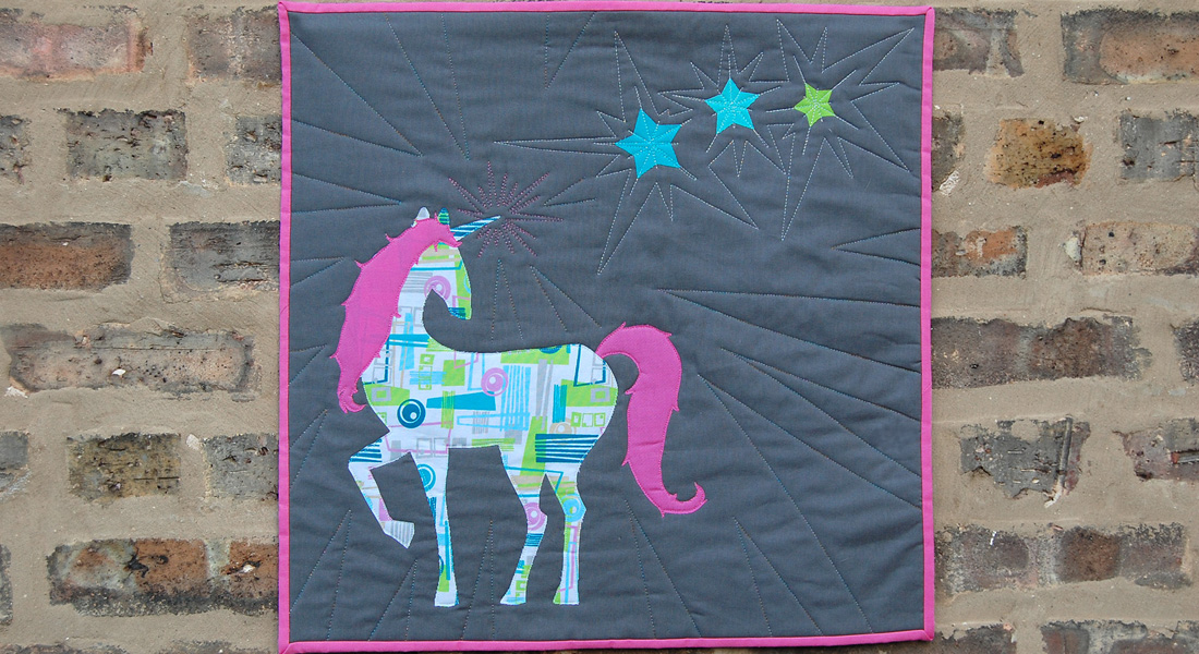 When you are happy with the quilting, square up your mini quilt with a ruler and rotary cutter.