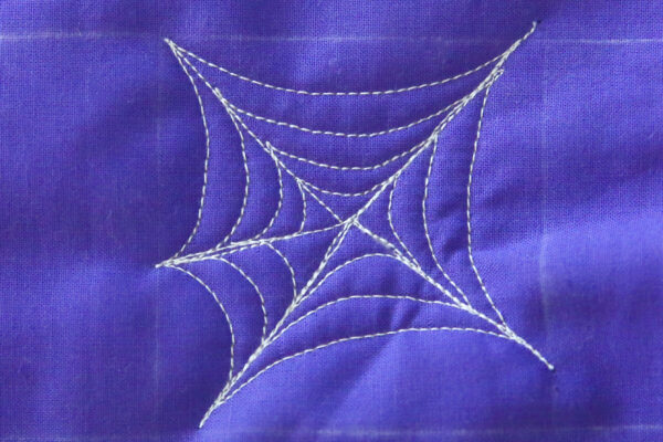 How to free-motion quilt a spider web and spider - step six