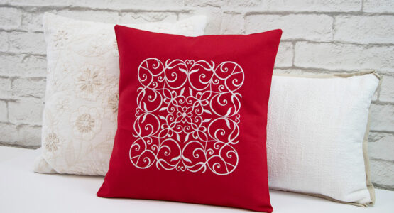 https://weallsew.com/wp-content/uploads/sites/4/2019/10/Wrought-Iron-Embroidered-Pillow-WeAllSew-Blog-1110x600-555x300.jpg