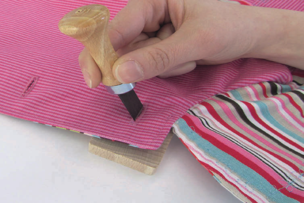 Buttonhole cutter in action