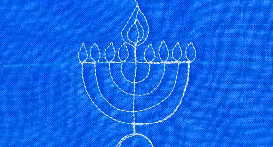 https://weallsew.com/wp-content/uploads/sites/4/2019/12/How-to-free-motion-quilt-a-menorah-from-WeAllSew-1100-x-600-555x300.jpg