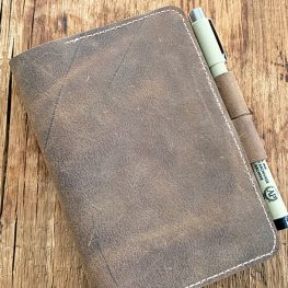 Leather Notebook Cover tutorial at WeAllSew