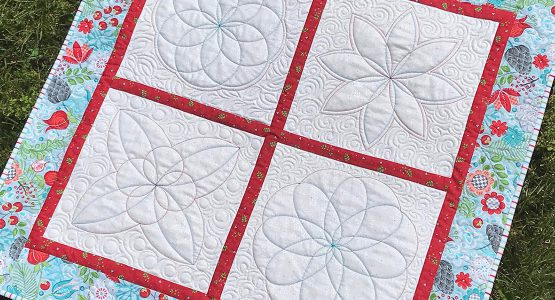 https://weallsew.com/wp-content/uploads/sites/4/2020/07/BERNINA-Blossoms-Quilt-with-Rulerwork-WeAllSew-1110x600-555x300.jpg
