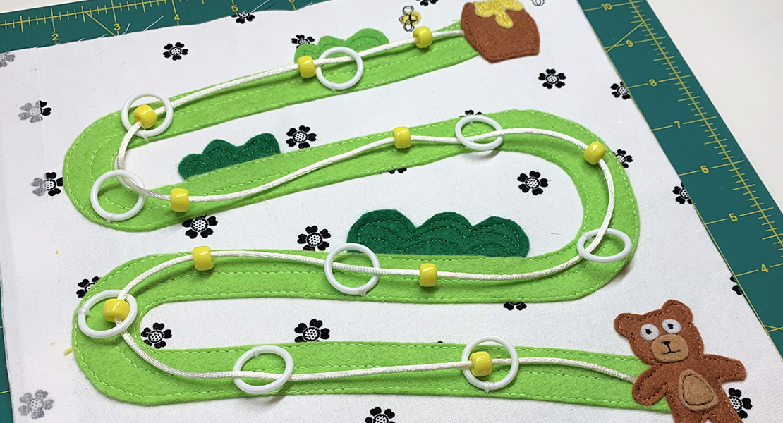 Let's start this month with Bear and Honey Pot. We will create a pathway to help Bear follow the bees to the Honey Pot. This activity involves fine motor skills for little hands