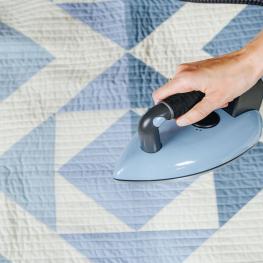 pressing a quilt
