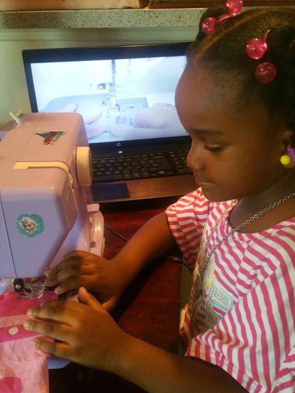 Paris is practicing her sewing skills
