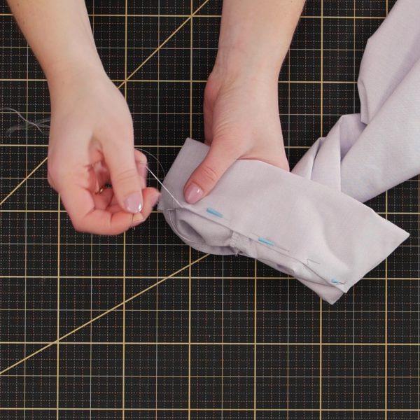 Garment_Sew-along_Part_7_Cuffs_handstitching_cuff_edge_in_place
