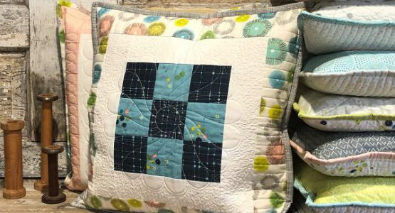 https://weallsew.com/wp-content/uploads/sites/4/2020/11/Rulerwork_for_Beginners_Month-9_00-pillow_BERNINA_WeAllSew_Blog_1200x1000px-600x400-1-555x300.jpg