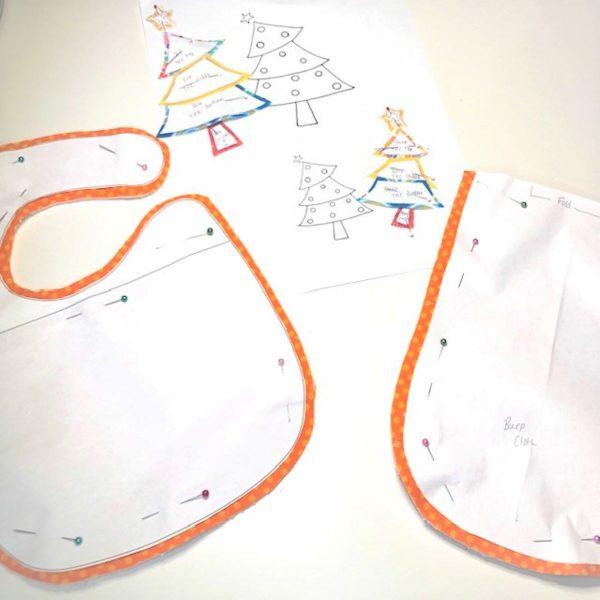 Appliqued Bib Burp Cloth Set Tutorial: fusible applique pieces in place
