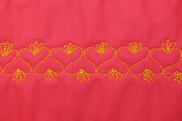 Free Motion Quilt Hearts in a Border - Embellishment on top