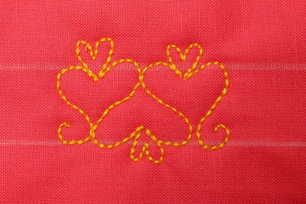 Free Motion Quilt Hearts in a Border - Small heart embellishment