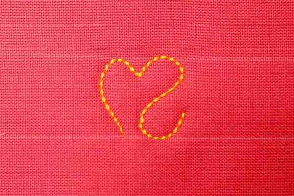 Free Motion Quilt Hearts in a Border - Right side with backwards S