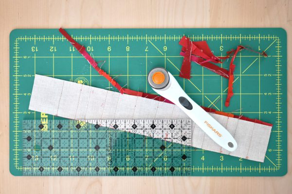 Then repeat the above steps until the foundation strip of muslin is completely covered by the scraps of fabric.