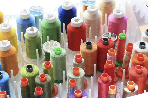 High and low sheen thread